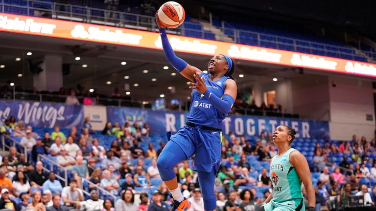 Arike Ogunbowale rises to score against the New York Liberty