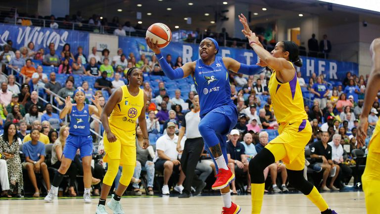 Arike Ogunbowale drives to the basket to score against the Los Angeles Sparks