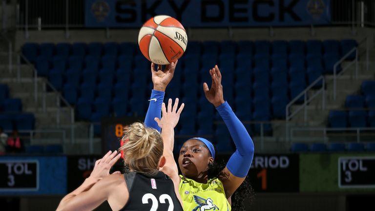 Arike Ogunbowale fires a jump shot over Courtney Vandersloot