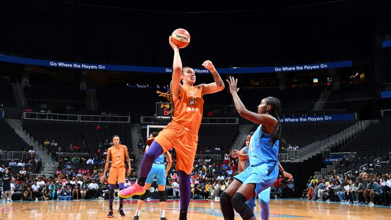 Brittney Griner lofts a jump hook against Atlanta