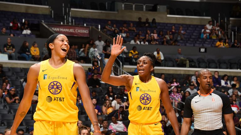 Candace Parker and Nneka Ogwunike celebrate the Sparks' win over the Mercury