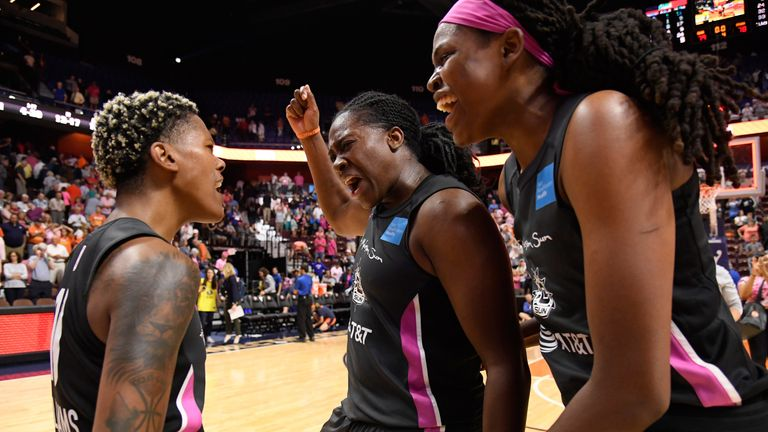 Courtney Williams celebrates with her Sun team-mates
