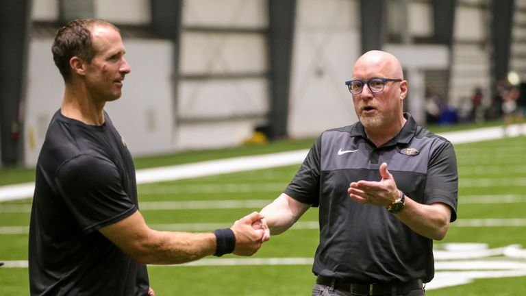 David Griffin attends a New Orleans Saints practice with Drew Brees