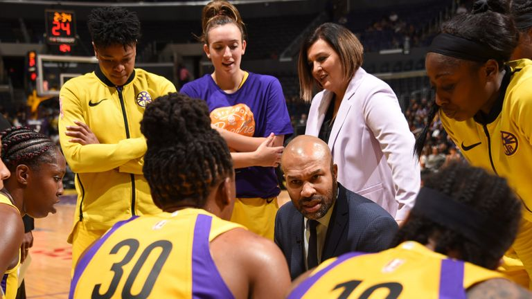 Sparks coach Derk Fisher lays out the gameplan during a time out