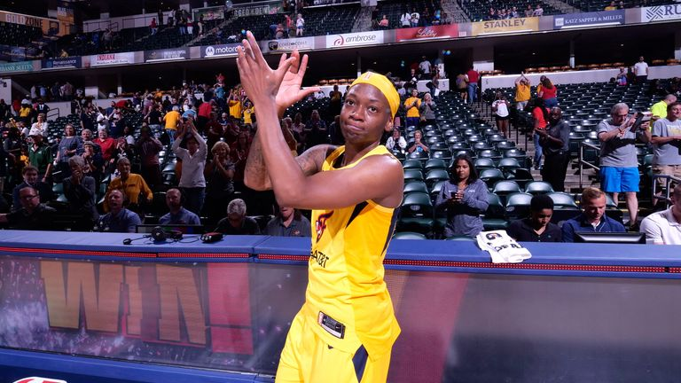 Erica Wheeler applauds the crowd after the Indiana Fever's win over the Atlanta Dream