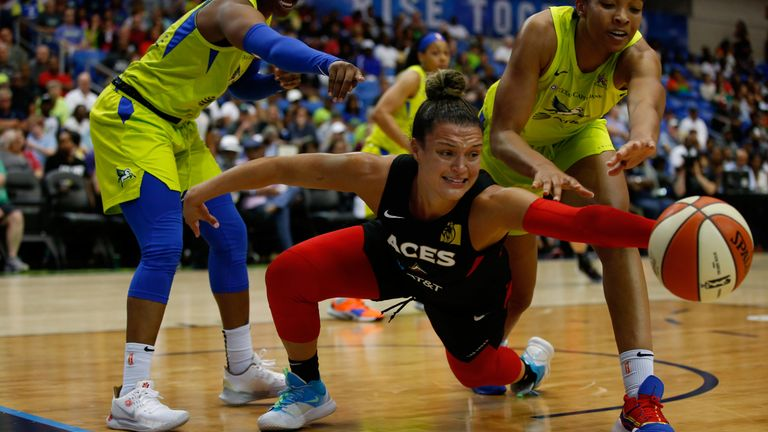 Kayla McBride dives for the ball against the Dallas Wings