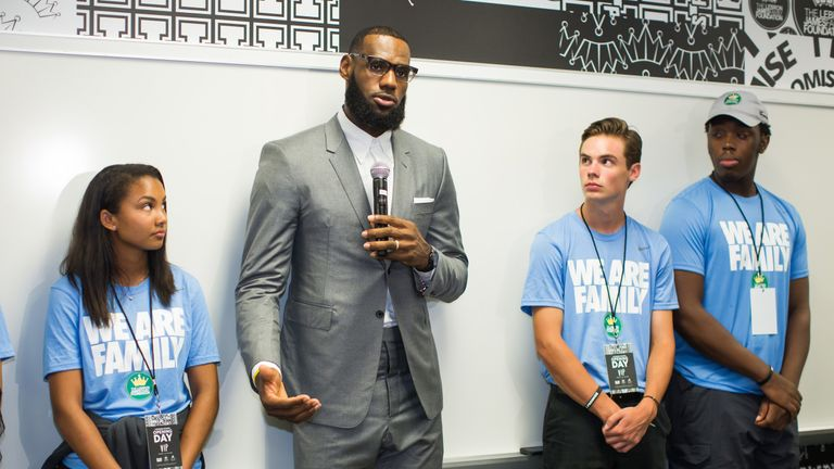 LeBron James speaks to children at the opening of the I Promise school in Akron, Ohio