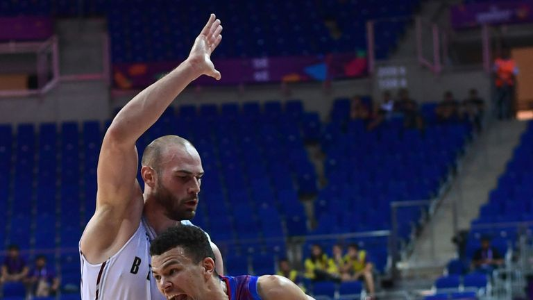 Luke Nelson drives to the basket for Great Britain