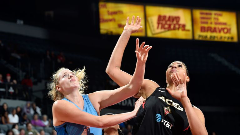 Marie Gulich of the Atlanta Dream battles Las Vegas Aces' Liz Cambage for a rebounds