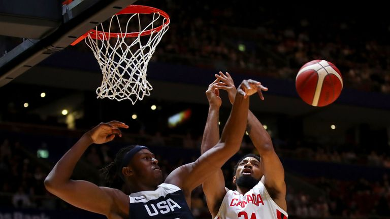 Myles Turner competes for a rebound against Canada