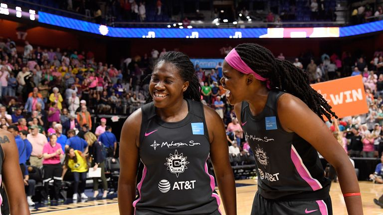 Shekinna Stricklen is congratulated by Jonquel Jones during the Sun's victory over Seattle