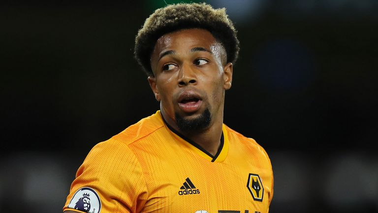 Adama Traore takes a breather during Wolves' match with Manchester United.