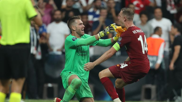 Adrian celebrates his shoot-out save with Jordan Henderson
