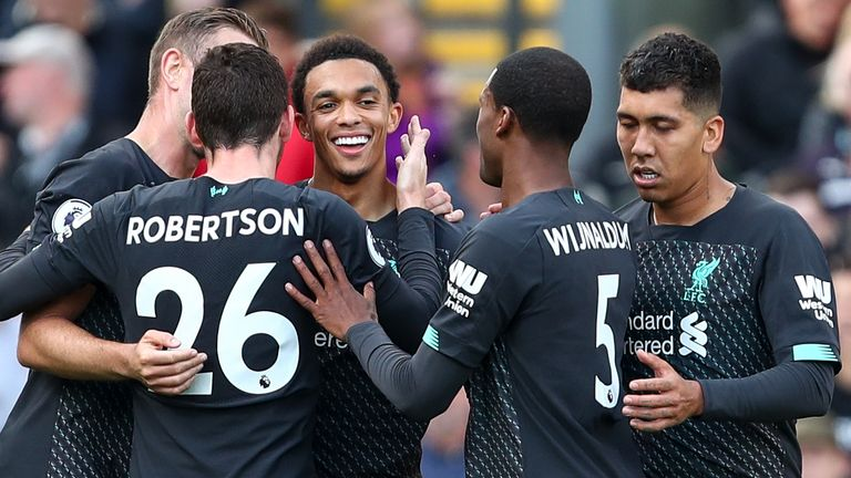 Trent Alexander-Arnold is congratulated after his cross forced an own goal from Burnley striker Chris Wood