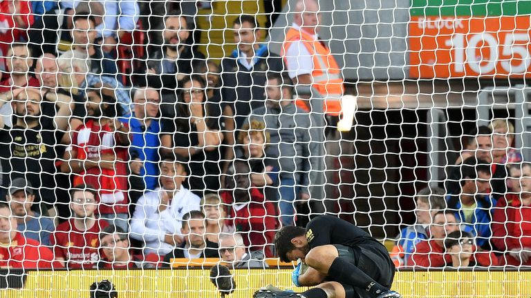 Alisson goes down with an injury during Liverpool's match vs Norwich City