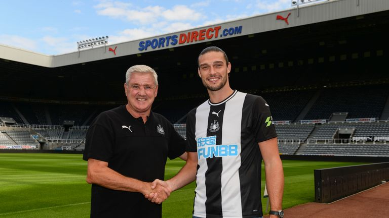 Andy Carroll shakes hands with Steve Bruce after rejoining Newcastle United