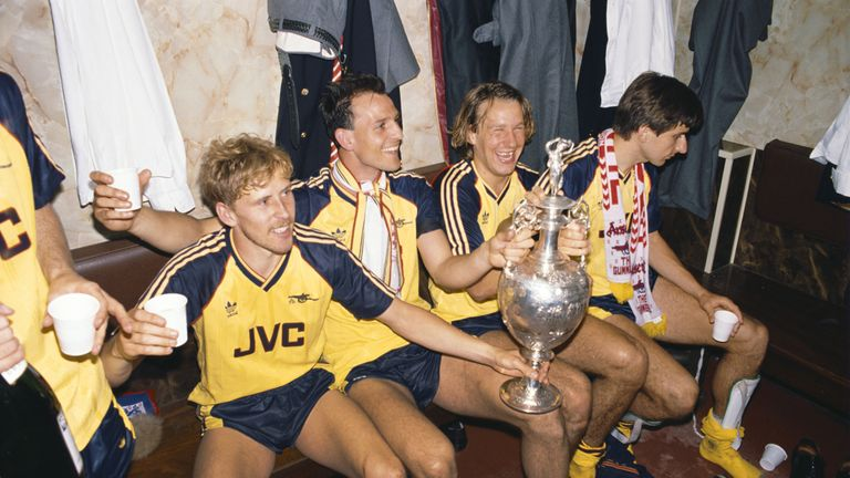 Kevin Richardson, Steve Bould and Paul Merson toast the famous win at Anfield