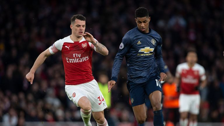 LONDON, ENGLAND - MARCH 10: Granit Xhaka of Arsenal and Marcus Rashford of Manchester United during the Premier League match between Arsenal FC and Manchester United at Emirates Stadium on March 10, 2019 in London, United Kingdom. (Photo by Visionhaus/Getty Images)