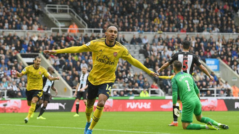 Pierre-Emerick Aubameyang celebrates opening the scoring for Arsenal at Newcastle