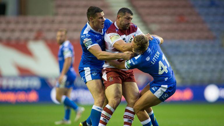 Ben Flower is tackled by Joel Tomkins and Jez Litten of Hull KR during an engrossing contest