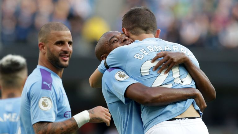 Fernandinho embraces Bernardo Silva after he makes it 4-0
