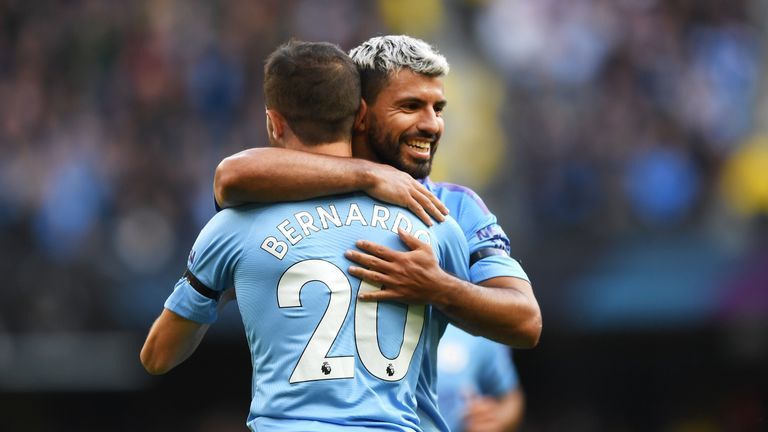Bernardo Silva celebrates with team-mate Sergio Aguero on Saturday