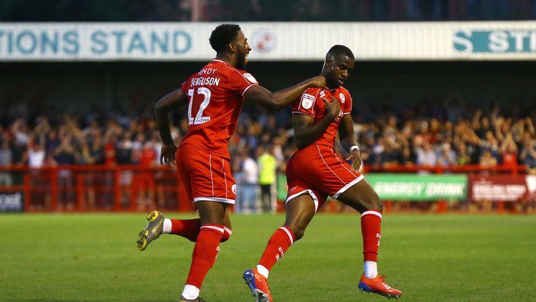 Crawley Town's Beryly Lubala (right) celebrates scoring against Norwich