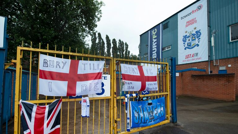 Banners and messages of support left outside Gigg Lane following Bury's expulsion from the Football League