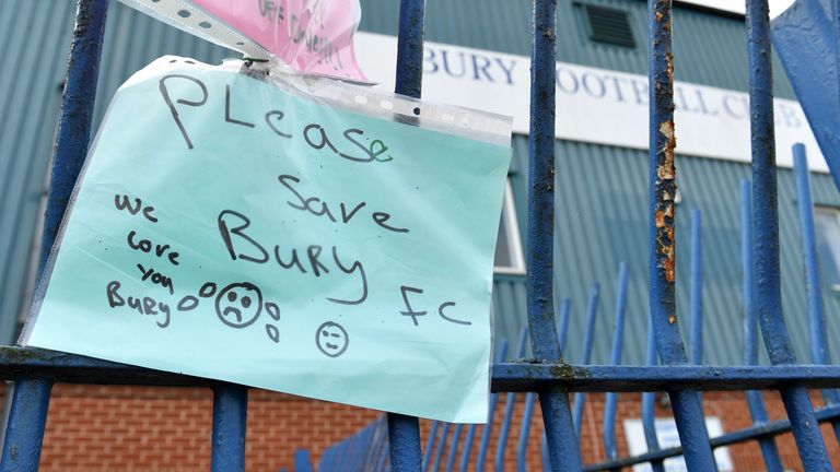 A note written by fans of Bury FC pinned to the gates at Gigg Lane