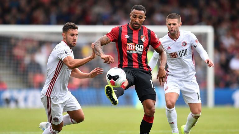 Callum Wilson is closed down by George Baldock (L) and Oliver Norwwod