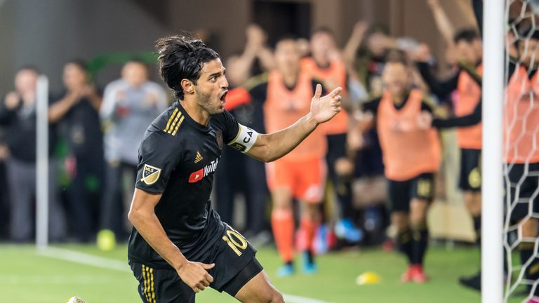 LOS ANGELES, CA - AUGUST 25:  Carlos Vela #10 of Los Angeles FC celebrates his goal during Los Angeles FC's MLS match against Los Angeles Galaxy at the Banc of California Stadium on August 25, 2019 in Los Angeles, California.  The match ended in a 3-3 draw.  (Photo by Shaun Clark/Getty Images) *** Local Caption *** Carlos Vela