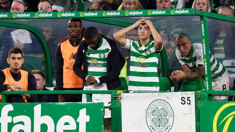 Celtic players react to their Champions League defeat