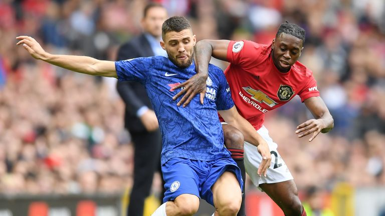 MANCHESTER, ENGLAND - AUGUST 11: Mateo Kovacic of Chelsea is challenged by Aaron Wan-Bissaka of Manchester United during the Premier League match between Manchester United and Chelsea FC at Old Trafford on August 11, 2019 in Manchester, United Kingdom. (Photo by Michael Regan/Getty Images)