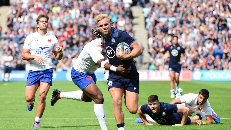 Chris Harris is tackled by Alivereti Raka during the Test at Murrayfield