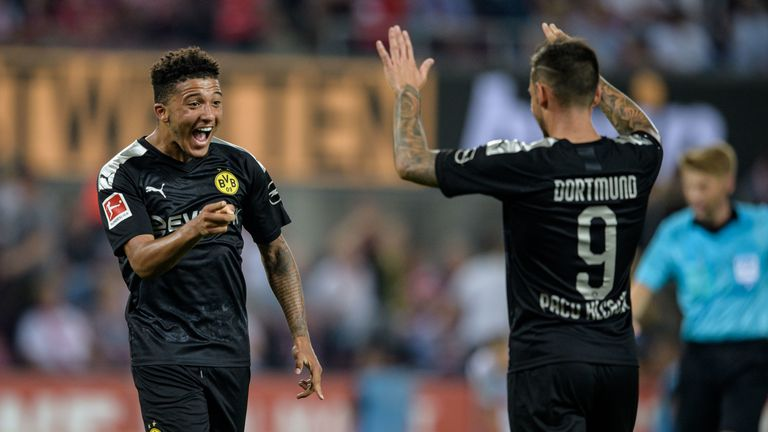 Sancho celebrates his goal with Paco Alcacer in the win over Cologne