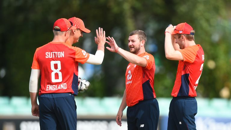 Callum Flynn (R) of England celebrates after taking a wicket during the Physical Disability World Series 2019 match against Rest Of The World XI at Worcester
