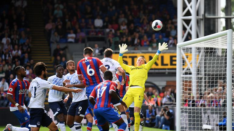 Scott Dann rises to see his header deflect over the bar during a cagey opening