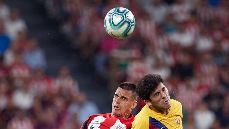 Dani Garcia of Athletic Bilbao competes for the ball with Barcelona's Carles Alena
