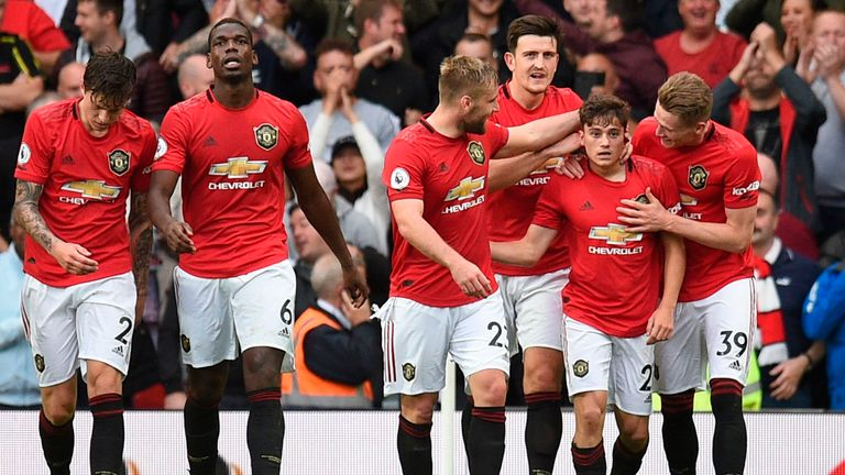 Manchester United's Daniel James (2nd R) celebrates with teammates after scoring their fourth goal on his Premier League debut during the match between Manchester United and Chelsea at Old Trafford in Manchester, north west England, on August 11, 2019. - Manchester United won the game 4--0.