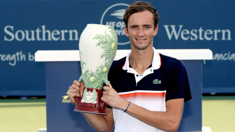 Daniil Medvedev of Russia poses for photographers after defeating David Goffin of Belgium during the men's final of the Western & Southern Open at Lindner Family Tennis Center on August 18, 2019 in Mason, Ohio