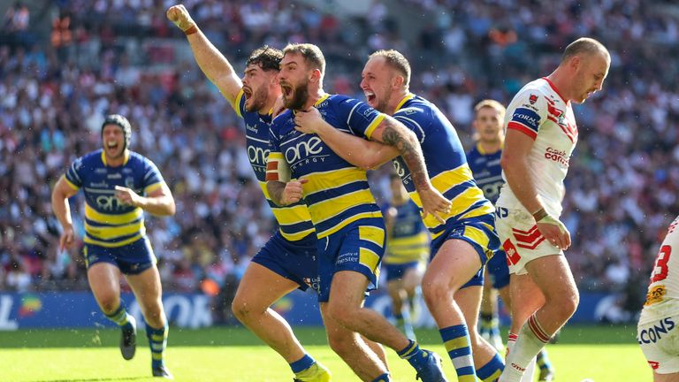 Lance Todd Trophy winner Daryl Clark celebrates the game-clinching try for Warrington