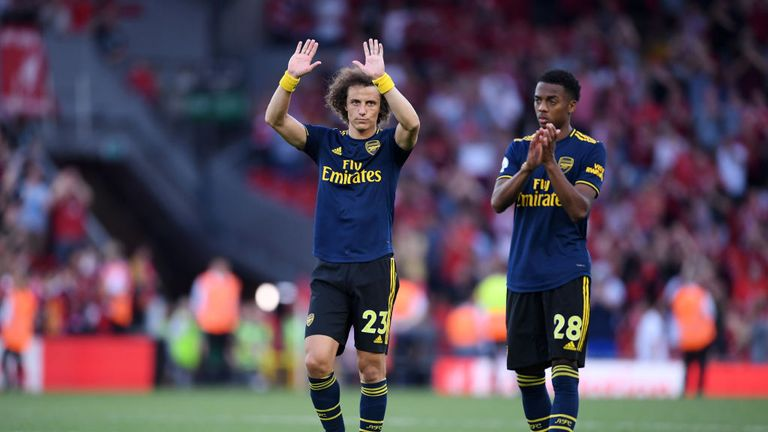 David Luiz holds his hands up to Arsenal fans after the defeat
