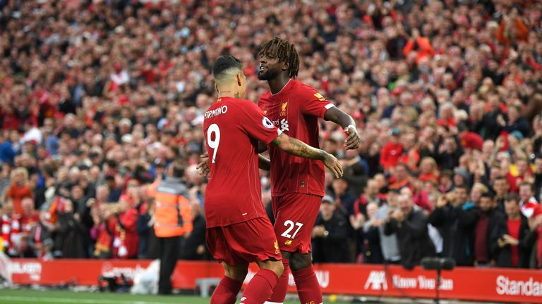 Divock Origi celebrates after his cross is deflected into the Norwich goal by Grant Hanley