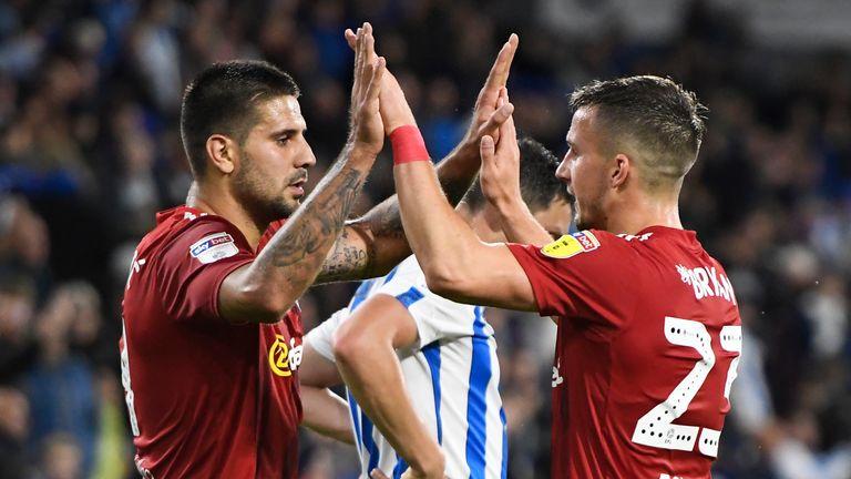 Aleksandar Mitrovic celebrates Fulham's victory at Huddersfield with Joe Bryan