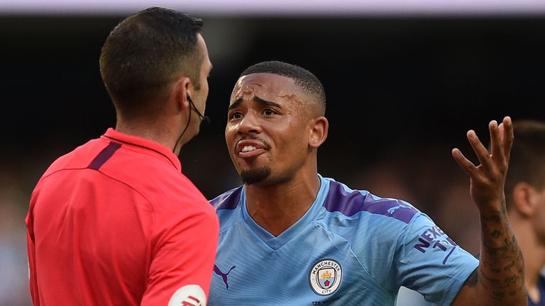 Manchester City's Brazilian striker Gabriel Jesus (R) remonstrates with English referee Michael Oliver after his goal was dissallowed following a VAR decision during the English Premier League football match between Manchester City and Tottenham Hotspur at the Etihad Stadium in Manchester, north west England, on August 17, 2019.