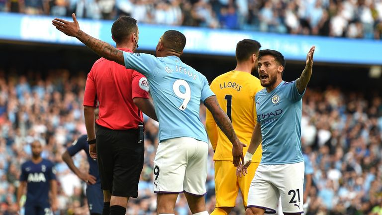 Manchester City's Brazilian striker Gabriel Jesus (2L) remonstrates with English referee Michael Oliver (L) after his goal was dissallowed following a VAR decision during the English Premier League football match between Manchester City and Tottenham Hotspur at the Etihad Stadium in Manchester, north west England, on August 17, 2019