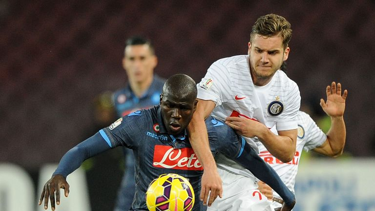 Puscas battling with Napoli's Kalidou Koulibaly during a Coppa Italia game in 2015
