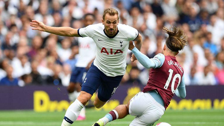 Tottenham's Harry Kane and Jack Grealish of Aston Villa in action