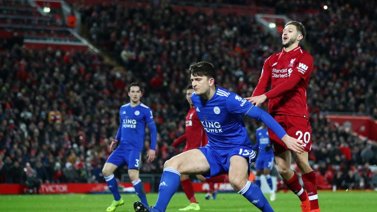 Harry Maguire and Adam Lallana during the Premier League match between Liverpool FC and Leicester City at Anfield on January 30, 2019 in Liverpool, United Kingdom.