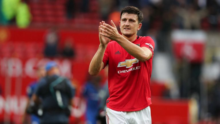 Maguire is applauded from the field after his man-of-the-match display against Chelsea